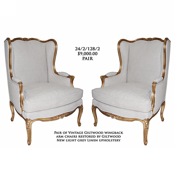 Giltwood wingback armchairs
